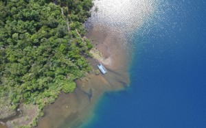 An aerial view of a river flowing into Lake Matano in Indonesia, which is 590 meters deep in places. (Shutterstock)