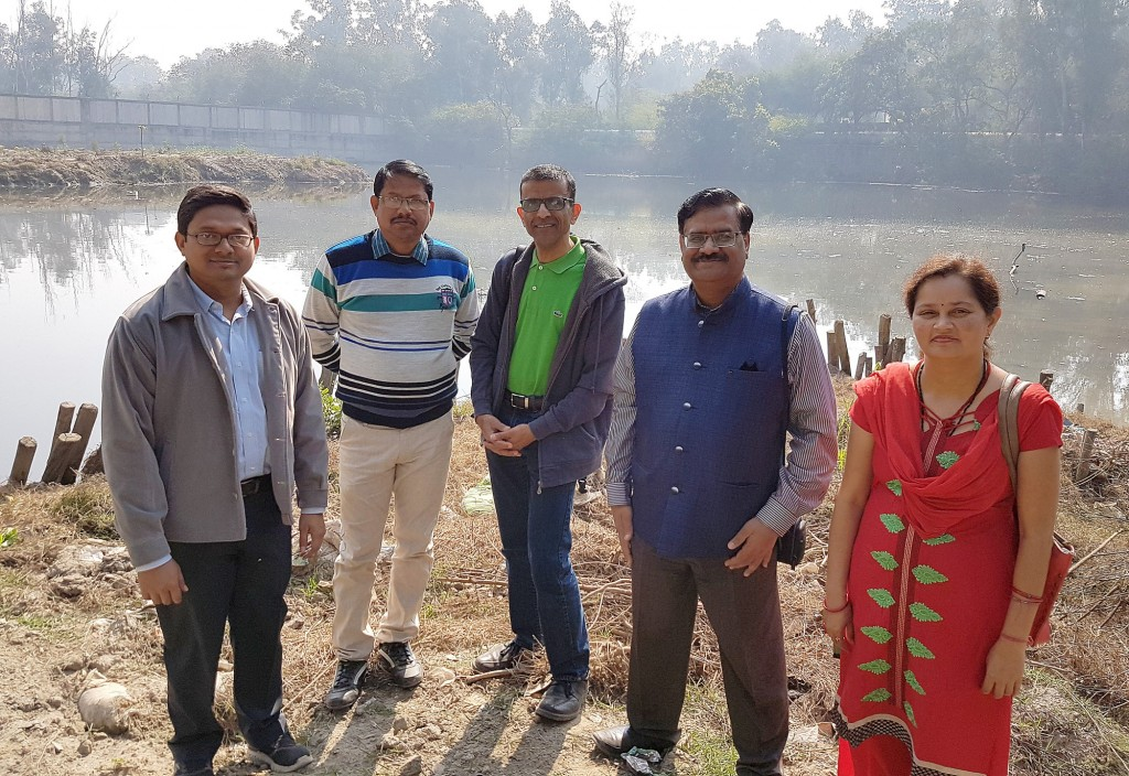 Left to Right: Dr. Tuhin Banerji, Scientist, CSIR-NEERI; Mukesh Kumar, Junior Engineer, Delhi Govt.; Dr. Rajesh Seth, University of Windsor; Dr. S.K. Goyal, Scientist and Head (Delhi Zonal Laboratory) CSIR – NEERI; and Rashmi Misra, CSIR-NEERI pose in front of the project site at Sonia Vihar Lake in India.